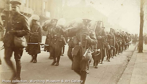 WW1 soldiers marching in a street in Worthing