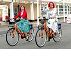 Tara Page and Emily Wilson, from Miss Molly in Worthing, help launch the bike hire scheme in Worthing - tile