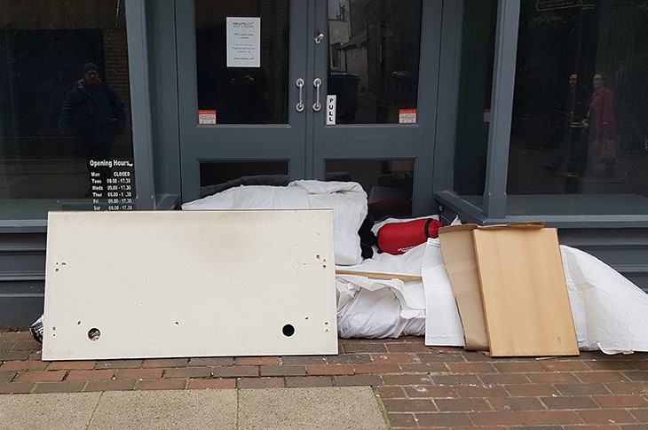 2019-03-14 - A rough sleeper's belongings in a shop doorway